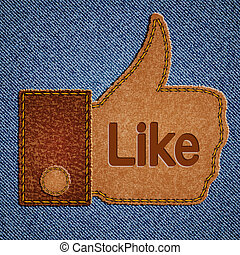 Like sign. Leather Thumbs up symbol on blue jeans background...