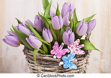 Lilac bunch of tulips on wooden board