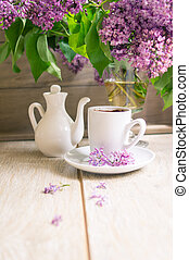Lilac flowers and coffee - Cup of black coffee and lilac...
