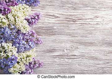 Lilac Flowers Bouquet on Wooden Plank Background Purple