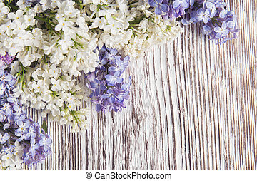Lilac Flowers Bouquet on Wooden Plank Background
