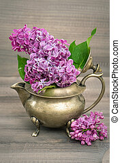 lilac flowers in antique vase