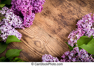 Lilac flowers on brown wood background