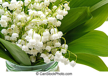 lilies of the valley in a glass jar