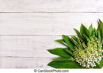 Lilies of the valley on wooden background, copy space