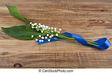 lilies of the valley on wooden background