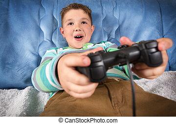lille dreng, boldspil spille video