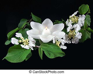 Lily Light - Glowing lotus candle in flower arrangement.