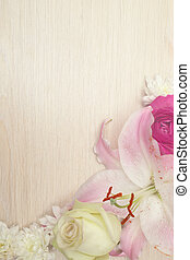 Lily on wooden background