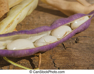 Lima beans on  wooden table