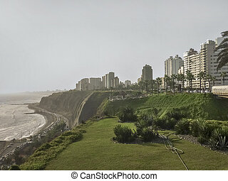 Unusual and original point of view of the coast of Lima with whis modern buildings and his tall ravines.