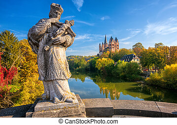 Limburg an der Lahn town, Hesse, Germany, view of the catholic cathedral with Saint John of Nepomuk statue on the medieval Old Lahn bridge