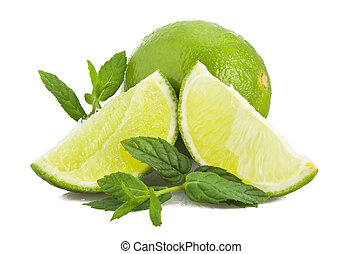 Lime and fresh leaves of mint on white