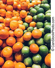 Lime And Tangerines Citrus Fruits In Fruit Market