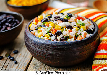 Lime black beans corn rice on a dark wood background. the...