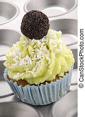 lime cupcake with grated coconut