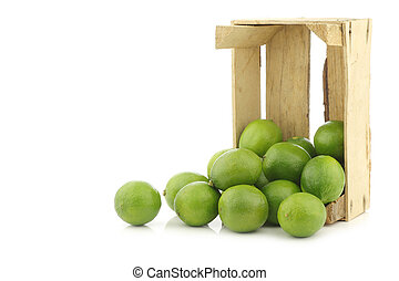 lime fruits in a wooden crate