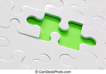Lime Green Jigsaw - White jigsaw with piece missing and lime...