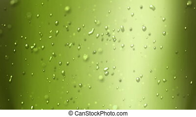 lime green juice - the bubbles floating up in the liquid of...