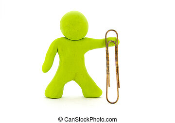Lime green plasticine character and big paperclip. Stationery. Isolated over white background