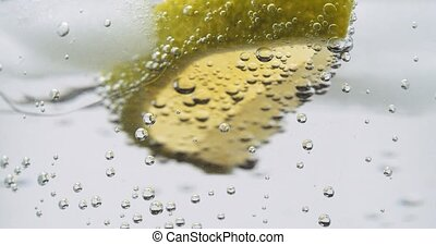 Lime ice and soda water bubbles turning close up - Macro ...