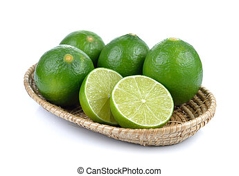 lime in the basket on white background