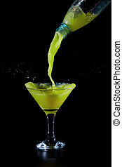 lime juice is being poured into a glass beaker