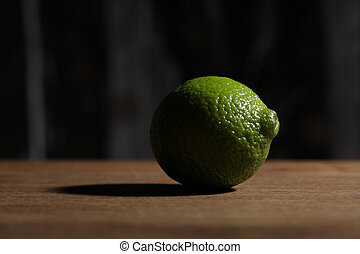 Lime on the wooden table. Close up