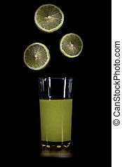 lime slices falling into the glass