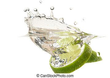 Lime splashing into water studio isolated on white ...