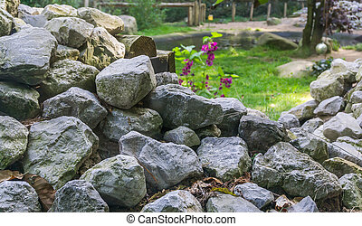 lime stone rocks stacked pile in a garden beautiful decorative texture background