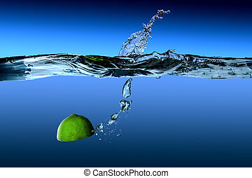 lime tropical fruit in water on a blue background