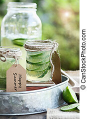 Limeade in mason jars with extreme shallow depth of field.