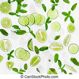 Limes, fresh mint and ice for mojito on white background.