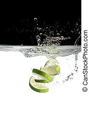 limes in water - some limes thrown in water with black and...