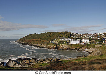 Limeslade bay at high tide in bright winter sunlight, Mumbles, Swansea, Wales, UK