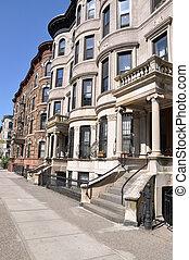 Limestone and brownstone homes along urban city Brooklyn New York sidewalk