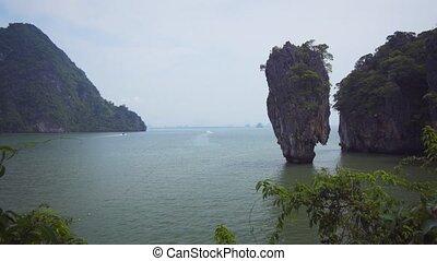Limestone formation jutting from sea - James Bond Island, in...