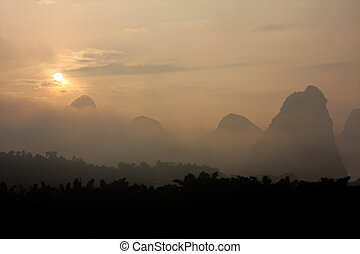 Limestone hills in mist, China