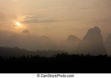 Limestone hills in mist, China