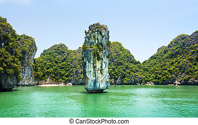 Limestone rocks and calm sea of Halong bay, Vietnam