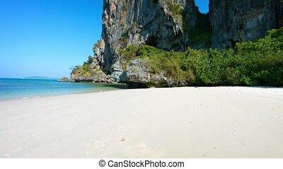Limestone Seacliffs, Rising from a Tropical Beach - Video...