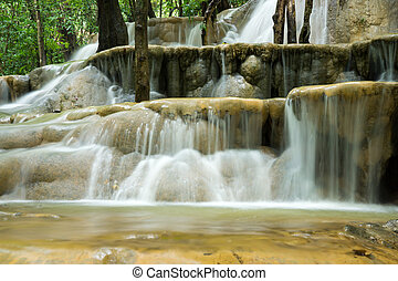 Limestone waterfall in the rainforest, Thailand.