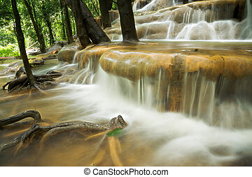 Limestone waterfall in the rainforest, Thailand.