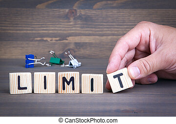 Limit from wooden letters on wooden background