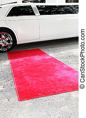 Limousine and red carpet - White stretch limousine and empty...