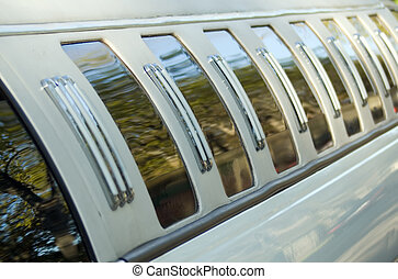 Limousine - There is a white limousine with black windows