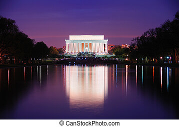 Washington DC - Lincoln Memorial at sunset with lake...