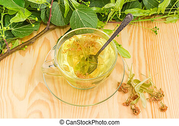 Linden flower tea in glass cup and dried linden flowers
