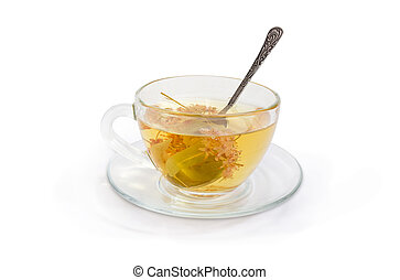 Linden flower tea in transparent glass cup with spoon